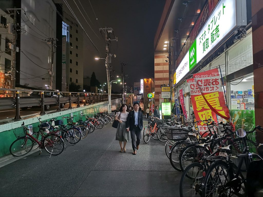 Bikes lining the sidewalk of a Tokyo storefront
