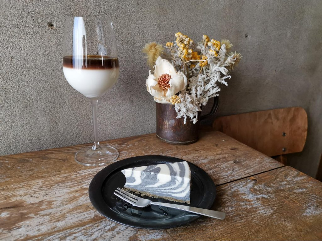 café glacé, a sweetened ice milk coffee that comes served in an elegant wine glass, along with the black sesame cheesecake that matches my leggings