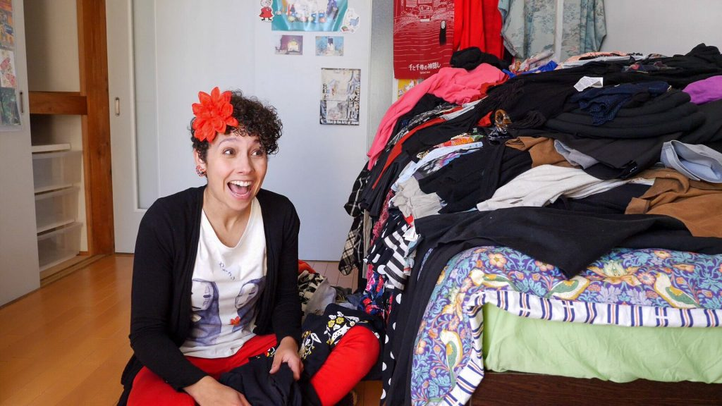 staring in amused horror at the mountain of clothes to sort through