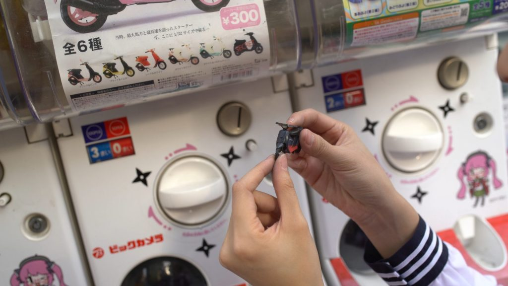 by the gashapon wall outside Bic Camera, Fay spent about 6,600 yen in an attempt to win a secret miniature Vespa