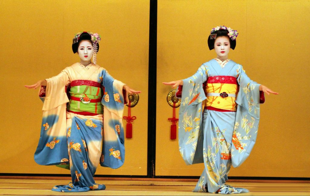 two Maiko doing a traditional dance